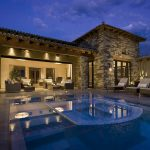 home-trends-2014-green-cutting-edge-technological-luxurious-and-entertaining-slate-stone-exterior-wall-small-luxury-home-design-with-infinity-pool-lounge-and-lighting-ideas